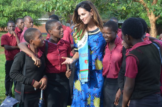 Planting tree as symbol of partnership at primary school in Malawi